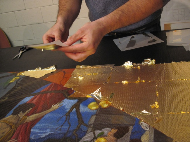 The artist applying of gold leaf to his painting 'Pactolus' (2011)